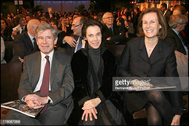 Alain Minc his wife and Mrs Winckler at Art Collections Of Yves Saint Laurent And Pierre Berge Auction Party