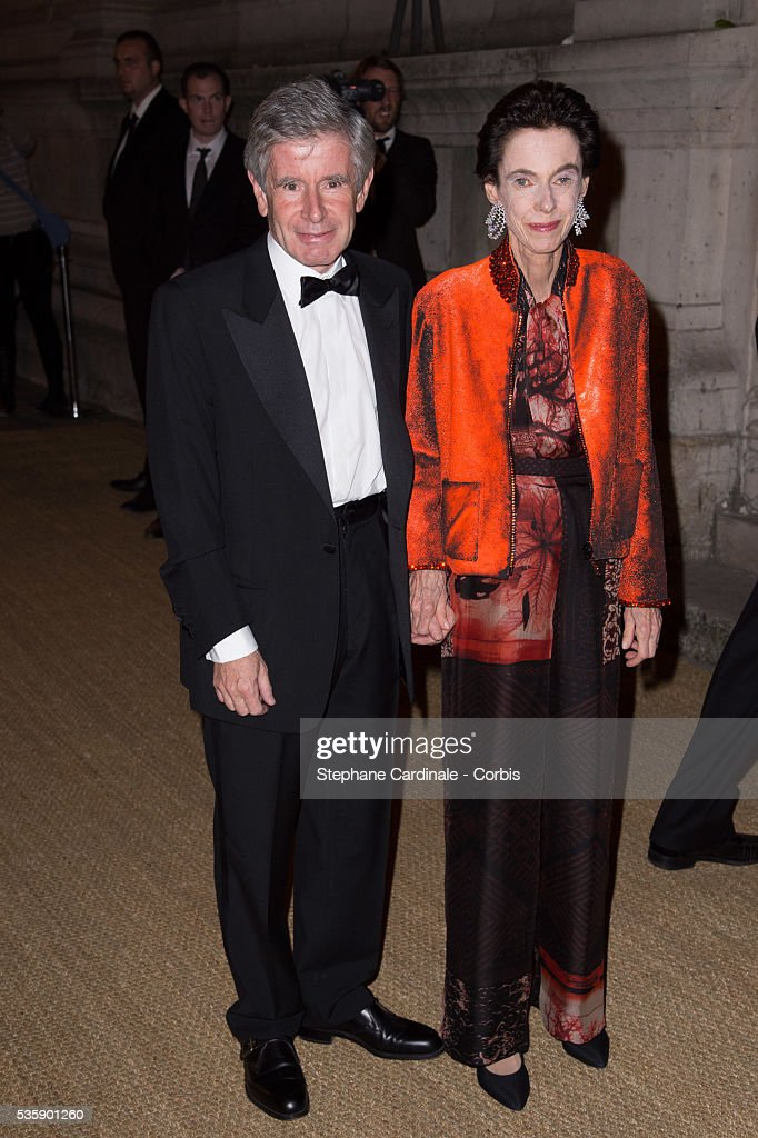 Alain Minc with his wife arrive at a Ralph Lauren Collection Show and private dinner at Les Beaux-Arts de Paris on October 8, 2013 in Paris, France. On this occasion Ralph Lauren celebrates the restoration project and patron sponsorship of 'L'Ecole des Beaux-Arts'.