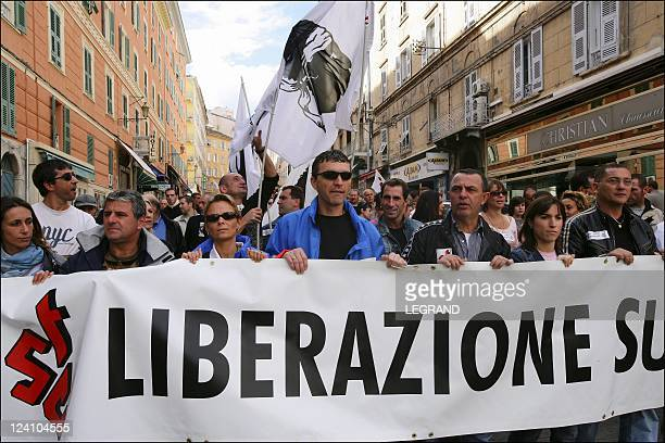 Alain Mosconi JeanGuy Talamoni and Edmond Simeoni at the social manifestation In Bastia France On October 04 2005 Several thousand people marched in...