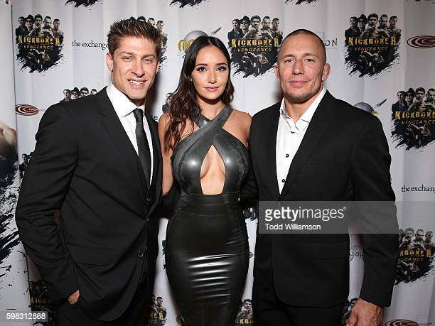 Alain Moussi Sara Malakul Lane and Georges StPierre attend the premiere Of RLJ Entertainment's 'Kickboxer Vengeance' at iPic Theaters on August 31...