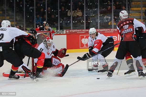 Alain of Bern challenges the Defence of Jyvaskyla during the Champions Hockey League Round of 16 match between SC Bern and JYP Jyvaskyla at...