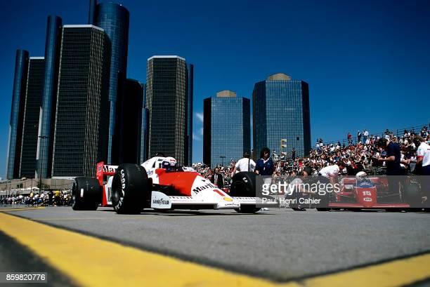 Alain Prost Alan Jones McLarenTAG MP4/2C LolaFord THL2 Grand Prix of Detroit Detroit street circuit June 22 1986 Alain Prost in the pits of the...