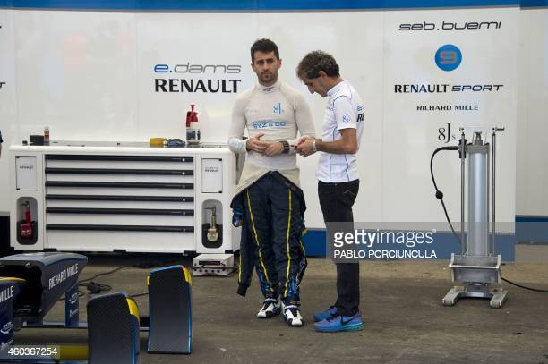 Alain Prost copartner of EDams Renault and his son Formula E driver Nicolas Prost speak in the pits in Punta del Este resort some 134 kms east of...