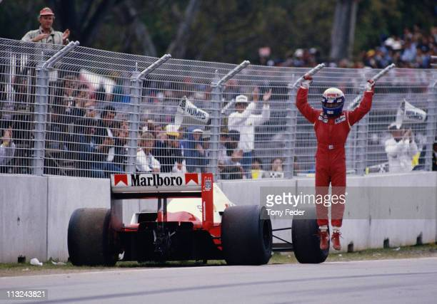 Alain Prost driver of the Marlboro McLaren International McLaren MP42C TAG 15 V6Tjumps in the air and raises his arms aloft in celebration after...