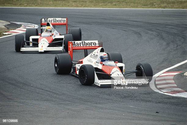 Alain Prost drives the Marlboro McLarenHonda MP4/5 ahead of his team mate Ayrton Senna just before the two drivers would contoversially collide...