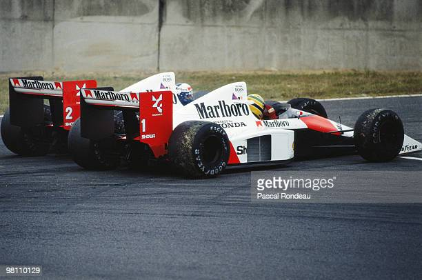 Alain Prost driving the Marlboro McLarenHonda MP4/5 controversially collides with his team mate Ayrton Senna during the Japanese Grand Prix on 22...
