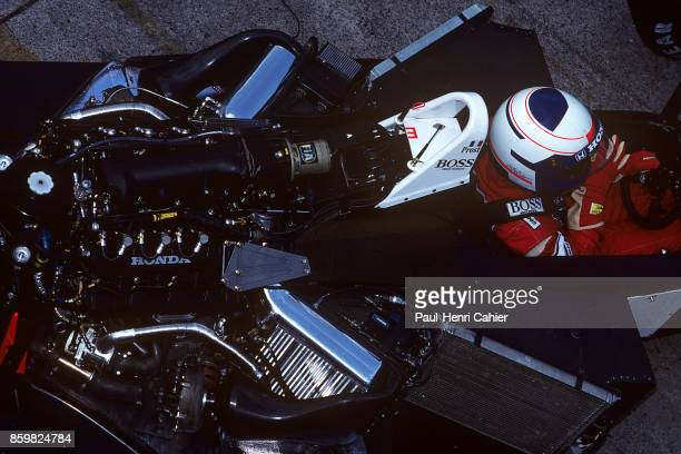 Alain Prost McLarenHonda MP4/4 Grand Prix of Hungary Hungaroring August 7 1988 The Honda RA168E 15 V6 turbo engine sits in the back of Alain Prost's...