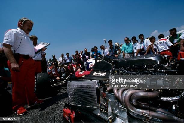 Alain Prost Neil Oatley McLarenHonda MP4/5 Grand Prix of France Circuit Paul Ricard July 9 1989 McLaren engineer Neil Oatley watches as Alain Prost...