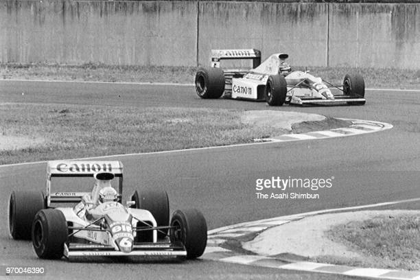 Alain Prost of France and McLaren-Honda leads to Ayrton Senna of Brazil and McLaren-Honda in the race of the Formula One Japanese Grand Prix at...