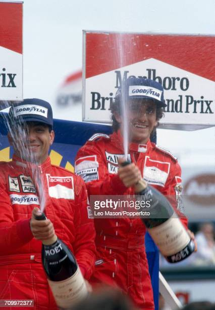 Alain Prost of France celebrates with champagne after winning the British Grand Prix driving a Mclaren MP4/2B with a TAG V6 engine for the Marlboro...