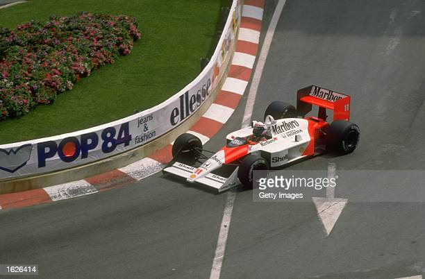 Alain Prost of France cuts close to a corner in his McLaren Honda during the Monaco Grand Prix at the Monte Carlo circuit in Monaco. Prost finished...