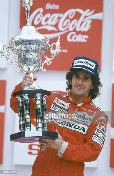 Alain Prost of France driver of the Honda Marlboro McLaren McLaren MP4/4 Honda V6 t pictured celebrating with the trophy on the podium after...