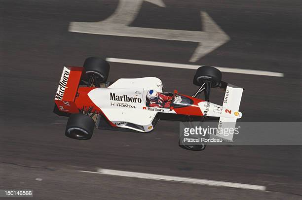 Alain Prost of France drives the Honda Marlboro McLaren MP4/5 Honda V10 during practice for the Iceberg United States Grand Prix on 3rd June 1989 at...