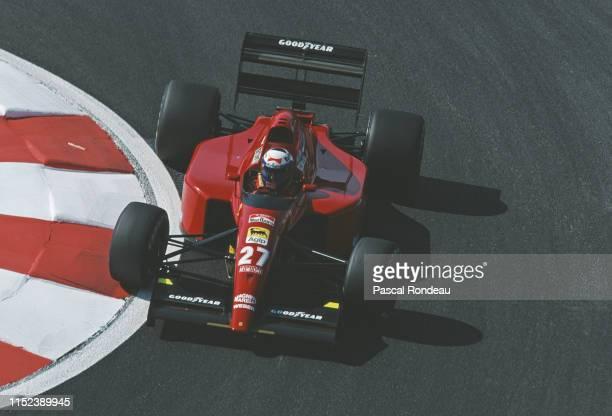 Alain Prost of France drives the Scuderia Ferrari SpA Ferrari 643 Ferrari V12 during practice for the French Grand Prix on 6 July 1991 at the Circuit...
