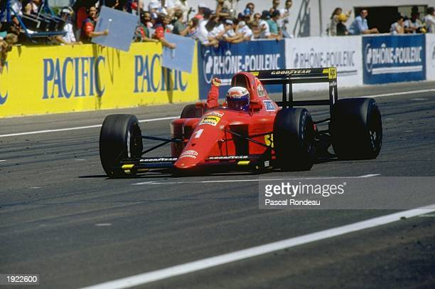 Alain Prost of France punches the air in celebration after passing the chequered flag in his Scuderia Ferrari to win the French Grand Prix at the...