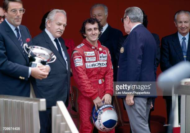 Alain Prost of France witih Prince Rainier III of Monaco after winning the Monaco Grand Prix, driving a McLaren PM 4/4 with a Honda V6 engine for the...