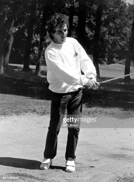 Alain Prost playing golf 1985