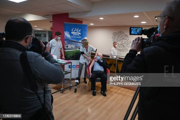 Alain receives a dose of the Pfizer-BioNTech Covid-19 vaccine at the Champmaillot EHPAD in Dijon, central France, on December 27, 2020 as France...