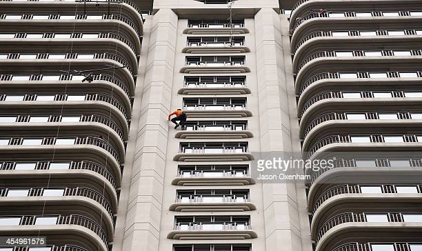 Alain Robert aka 'The French Spiderman' climbing the Metropolis Building during their lunch hour on December 11 2013 in Auckland New Zealand