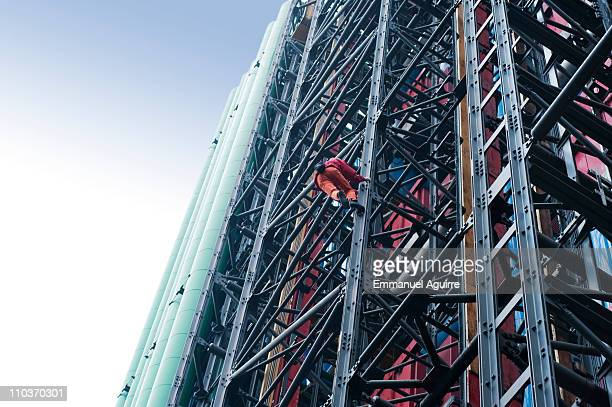 Alain Robert climbs the Pompidou Centre on March 17 2011 in Paris France Robert who has scaled more than 85 structures around the world successfully...
