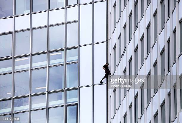 Alain Robert known as the French 'Spiderman' climbs the 'First' tower the highest building in France on May 10 2012 in Paris La Defense Hauts de...