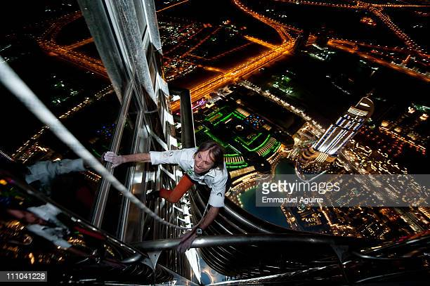 Alain Robert known as the French 'Spiderman' climbs the highest building in the world Burj Khalifa on March 28 2011 in Dubai United Arab Emirates...