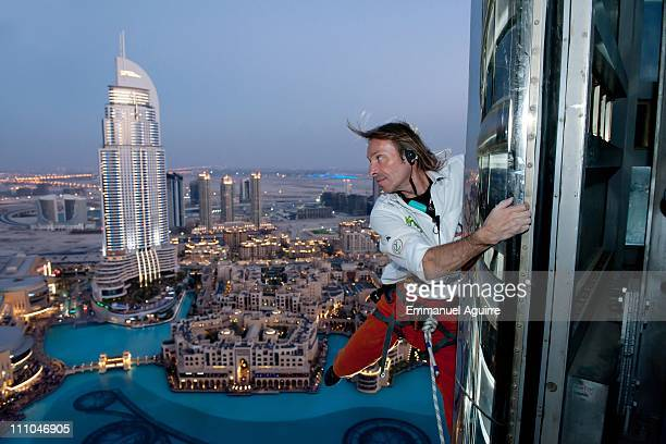 Alain Robert known as the French 'Spiderman' looks across the cityscape climbs the highest building in the world Burj Khalifa on March 28 2011 in...