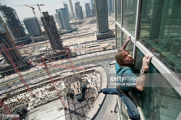 Alain Robert known as the French 'Spiderman' makes a practice climb on a hotel as part of a climbing reconnaissance of the highest building in the...