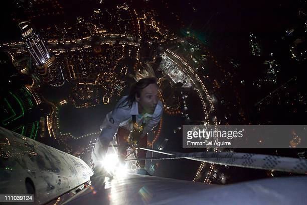 Alain Robert known as the French 'Spiderman' nears the completion of his climb of the highest building in the world Burj Khalifa on March 28 2011 in...