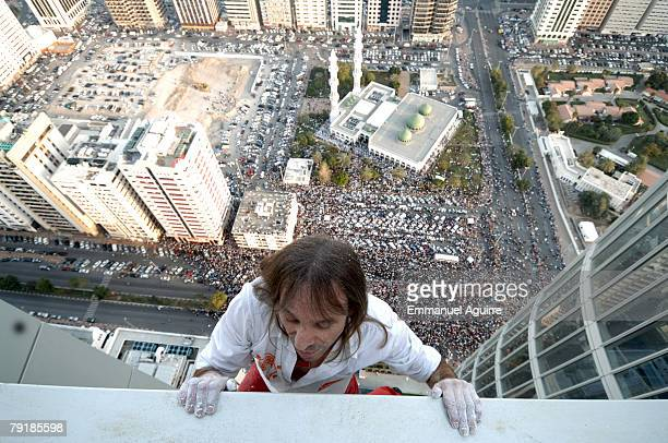 Alain Robert nicknamed the 'French Spiderman' climbs the Abu Dhabi Investment Authority Tower watched by a crowd of 100 000 onlookers on February 23...