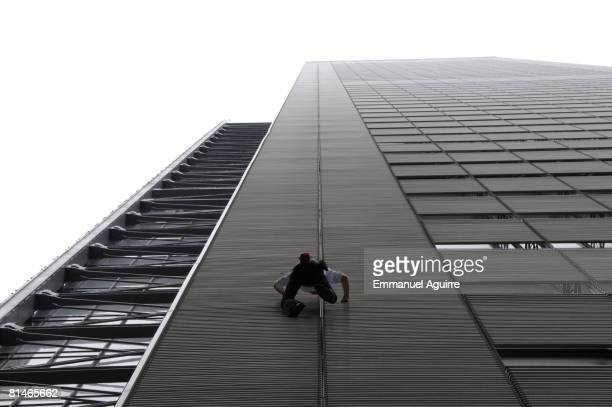Alain Robert the French 'Spiderman' climbs the 52story New York Times building June 5 2008 in New York City Robert who was arrested when he reached...