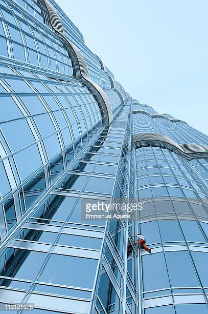 Alain Robert the 'French Spiderman' climbs the highest tower in the world Burj Khalifa on March 28 2011 in Dubai It took him six hours to ascend the...