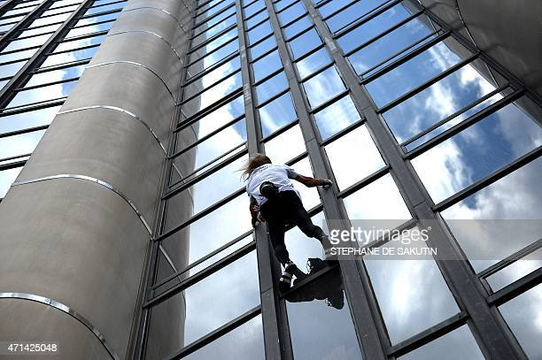 Alain Robert the French urban climber dubbed Spiderman climbs the 210m Tour Montparnasse skyscraper on April 28 2015 in Paris AFP PHOTO / STEPHANE DE...