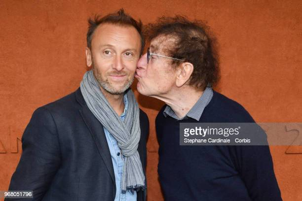 Alain Souchon and his son Pierre Souchon attend the 2018 French Open Day Ten at Roland Garros on June 5 2018 in Paris France