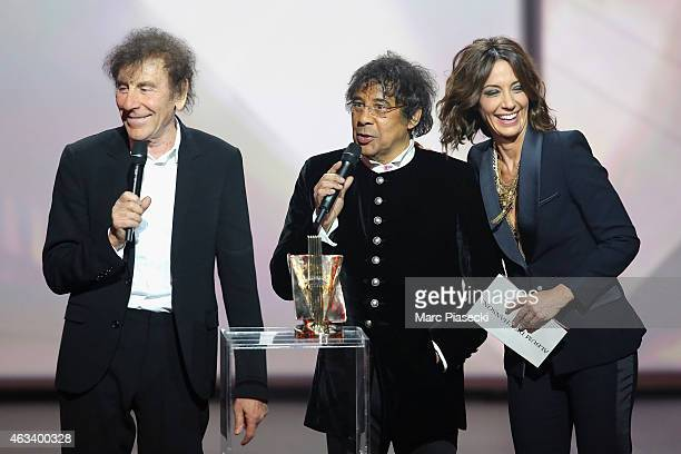 Alain Souchon and Laurent Voulzy receive from Virginie Guilhaume the album of songs award for 'Alain Souchon Laurent Voulzy' during the 30th...