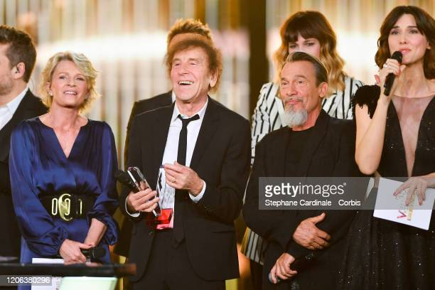 Alain Souchon ccelebrates after receiving the best album award next to French singer and president of honor Florent Pagny and Sophie Davant during...
