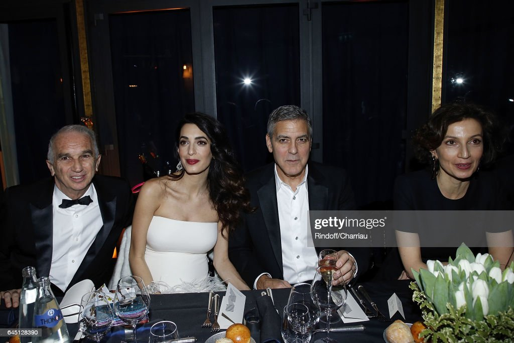 Alain Terzian, Amal Clooney, George Clooney and Audrey Azoulay attend the Cesar's Dinner at Le Fouquet's on February 24, 2017 in Paris, France.