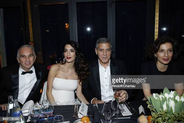 Alain Terzian Amal Clooney George Clooney and Audrey Azoulay attend the Cesar's Dinner at Le Fouquet's on February 24 2017 in Paris France