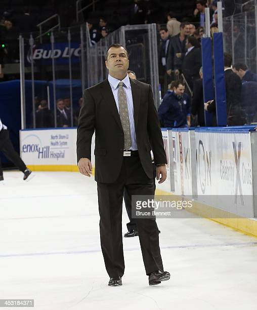 Alain Vigneault of the New York Rangers leaves the ice folowing the game against the Winnipeg Jets at Madison Square Garden on December 2 2013 in New...