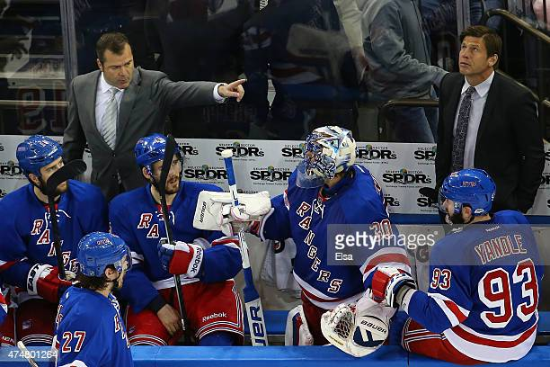 Alain Vigneault of the New York Rangers talks to his team as Henrik Lundqvist sits on the bench late in the third period against the Tampa Bay...