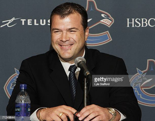 Alain Vigneault smiles as he takes questions from reporters after being named the new head coach of the Vancouver Canucks on June 20 2006 at General...