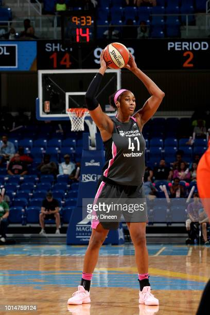 Alaina Coates of the Chicago Sky handles the ball during the game against the Connecticut Sun on August 10 2018 at the Allstate Arena in Chicago...