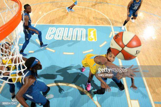 Alaina Coates of the Chicago Sky reaches for control of the ball against the Minnesota Lynx on July 07 2018 at the Wintrust Arena in Chicago Illinois...