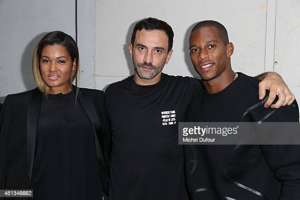 Alaina Watley Ricardo Tisci and Victor Cruz attend the Givenchy show as part of the Paris Fashion Week Menswear Spring/Summer 2015 on June 27 2014 in...
