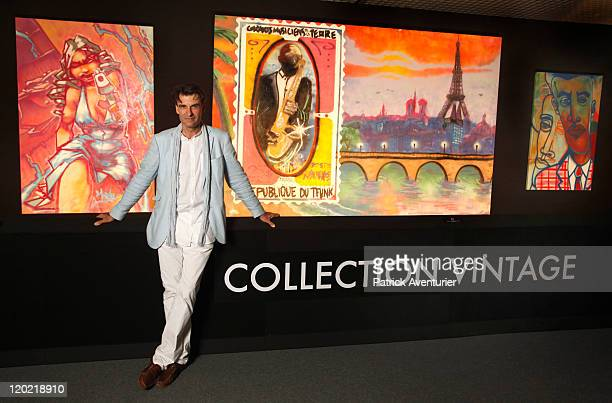 AlainDominique Gallizia poses with works of art on display at The Birth of Pressionism exhibition on August 1 2011 in Monaco This major exhibit at...