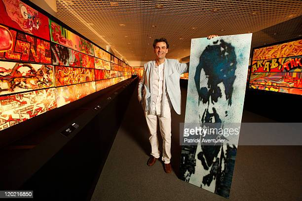 AlainDominique Gallizia with a work of art by artist Ash on display at The Birth of Pressionism exhibition on August 12011 in Monaco This major...