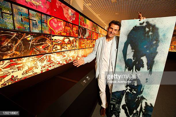AlainDominique Gallizia with a work of art by artist Ash on display at The Birth of Pressionism exhibition on August 1 2011 in Monaco This major...