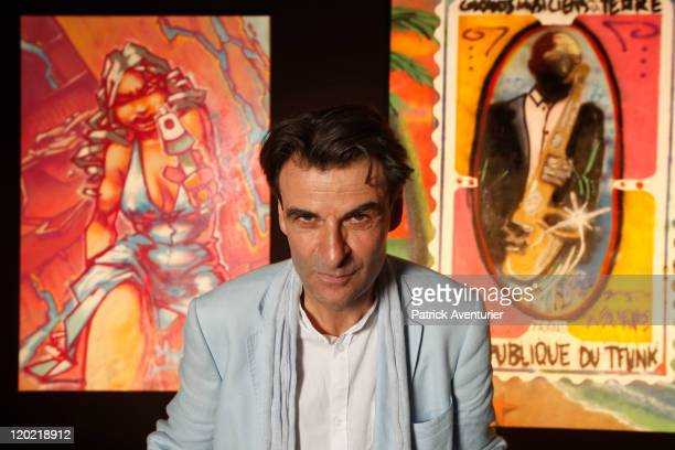 AlainDominique Gallizia with works of art on display at The Birth of Pressionism exhibition on August 1 2011 in Monaco This major exhibit at the...