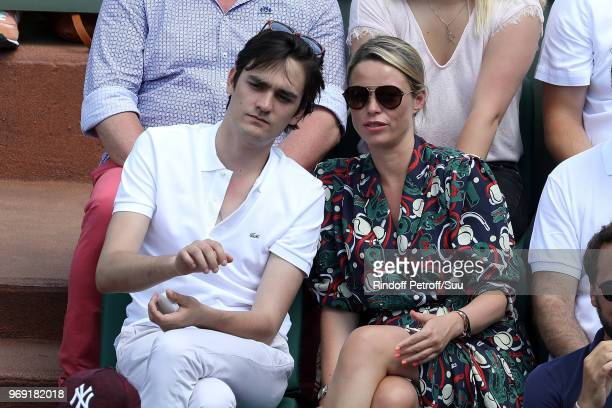 AlainFabien Delon and actress Kiera Chaplin attend the 2018 French Open Day Twelve at Roland Garros on June 7 2018 in Paris France