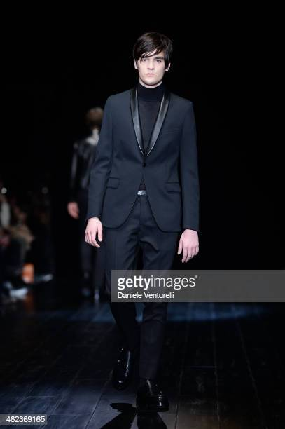 AlainFabien Delon walks the runway during the Gucci show as a part of Milan Fashion Week Menswear Autumn/Winter 2014 on January 13 2014 in Milan Italy